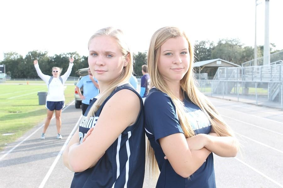 Seniors%2C+Emily+Harrell+and+Lindsey+Eaton+pose+before+heading+to+practice.+Emily+Harrell+is+known+for+playing+3+varsity+sports+%28basketball+pictured+here%29+while+Lindsey+Eaton+is+a+varsity+star+soccer+player.+